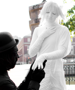 This Couple Took Their Engagement Shoot to the Next Level by Dressing Up as Statues