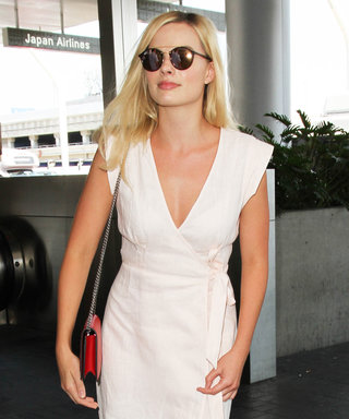 Margot Robbie Embodies Summer Travel Ease in a Blush Wrap Dress
