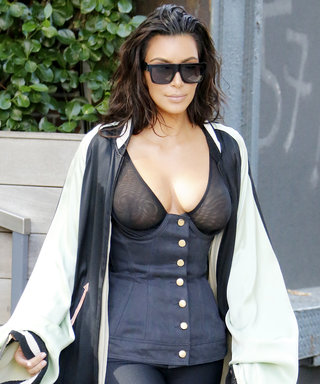 Kim Kardashian West Dons a Long Cape, Sheer Top, Bike Shorts, and Fur Slides in N.Y.C.