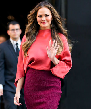 Chrissy Teigen Slays NYFW in a Fall-Ready Tangerine Top and Maroon Pencil Skirt
