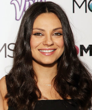 Mila Kunis's Baby Bump Is the Perfect Complement to Her Slouchy Denim Overalls
