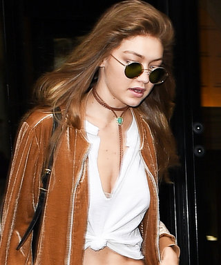 Gigi Hadid Demos How to Tie Up a Basic White Tee to Flaunt Her Washboard Abs
