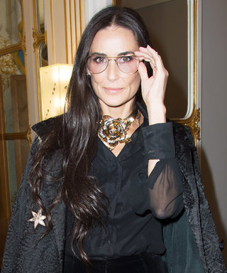 Demi Moore Makes a Spectacular PFW Appearance in '70s-Like Frames and an All-Black Ensemble