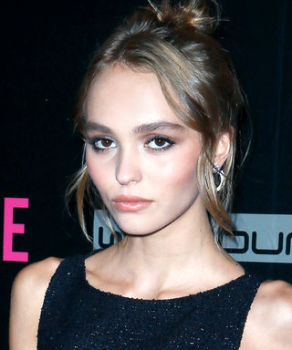Lily-Rose Depp Pairs Tomboy Basics with Bright Red Accessories