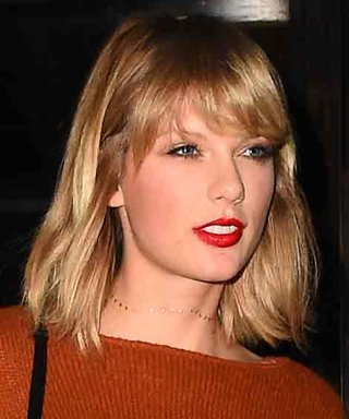 Taylor Swift Flashes a Hint of Her Abs in an Orange Cropped Sweater