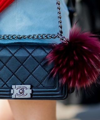 SYDNEY, AUSTRALIA - MAY 19, A black Chanel bag with Fendi fur ball at Mercedes-Benz Fashion Week Resort 17 Collections at Carriageworks on May 19, 2016 in Sydney, Australia.   (Photo by Christian Vierig/WireImage)