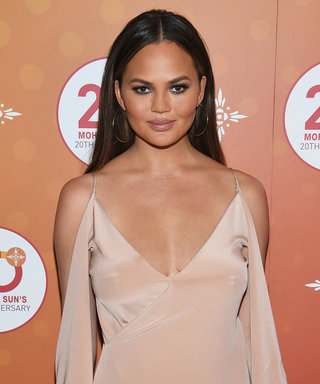 "Watch Chrissy Teigen Feed Daughter Luna Her First Bite of ""Savory"" Food"