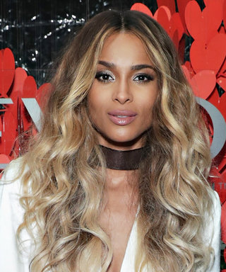 New Revlon Ambassador Ciara Looks White Hot in a Plunging Satin Suit