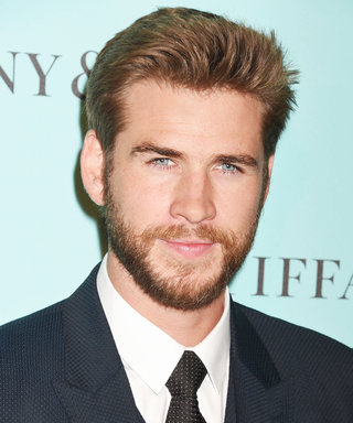 "Liam Hemsworth Is a Certified Cutie ""Riding"" His Dog on the Beach"