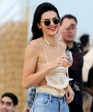 Kendall Jenner's Gravity-Defying Gold Top: An Analysis