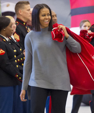 This content is subject to copyright. US First Lady Michelle Obama helps to sort donated toys for the Marine Corps Reserve Toys for Tots Campaign at Joint Base Anacostia-Bolling in Washington, DC, December 7, 2016. / AFP / SAUL LOEB        (Photo credit s