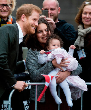 Prince Harry Plays with an Adorable Happy Baby and the Internet Can't Stop Fawning