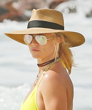 Britney Spears Flashes a Massive Ring on Her Wedding Finger While Out in a Yellow Bikini