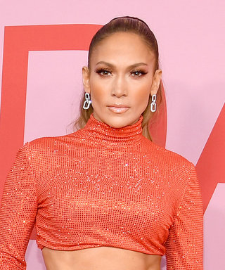 Jennifer Lopez Can't Stop Her Abs From Popping Out of Her Latest Red Carpet Look