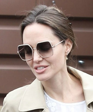 Angelina Jolie Just Rewore a $148 Trench Coat and Her Go-To Flats