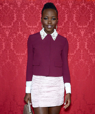 Lupita Nyong'o Jet-Sets to Paris For Miu Miu's #PFW Fall/Winter 2014 Collection, And Proves She's a Prada Cheerleader