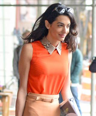 Amal Clooney in orange.