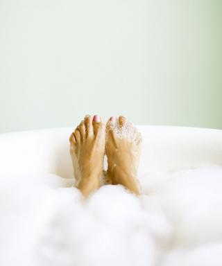 Feet soaking in bathtub