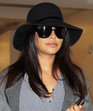 Naya Rivera Shows Off Her Baby Bump in Perfectly Layered Style at the Airport