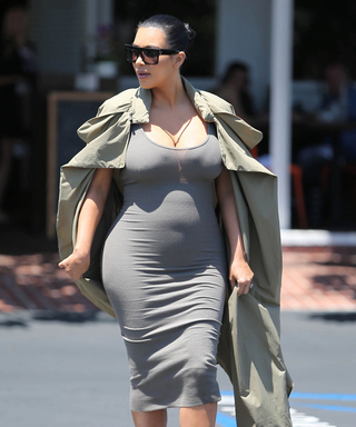 Kim Kardashian's Baby Bump Takes Shape in a Fitted Gray Dress