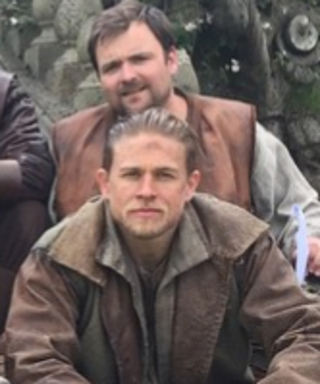 The 15 Hottest Behind-the-Scenes Photos of Charlie Hunnam From the Set of King Arthur