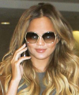 Chrissy Teigen Hits the Airport Wearing the Perfect Summer-to-Fall Look