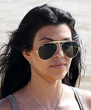 Kourtney Kardashian Shows Off Her Toned Physique in Sexy Bandage Bikini