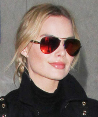 Margot Robbie Effortlessly Rocks Boyfriend Jeans and a Navy Coat While Traveling