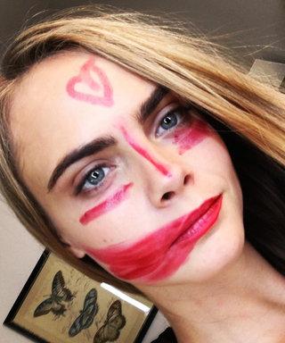 This Is Why Cara Delevingne Is Smearing Lipstick All Over Her Face