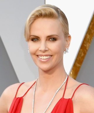 Charlize Theron Didn't Know What Her Red Hot Oscars Dress Looked Like Until a Week Ago