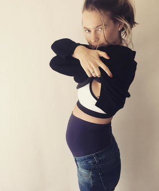 Behati Prinsloo Shows Off Her Cute Bump in First Pair of Maternity Jeans