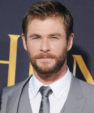 Chris Hemsworth Lets His Bare Abs Run Wild at the Beach—Watch