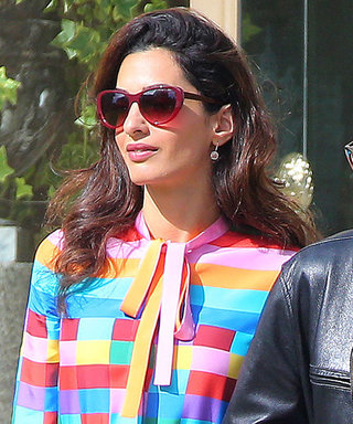 Amal Clooney Wows in a Bold Rainbow Dress as She Departs Cannes