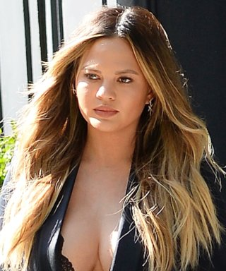 Chrissy Teigen Flaunts Her Assets in Plunging Lace Top on the Streets of N.Y.C.