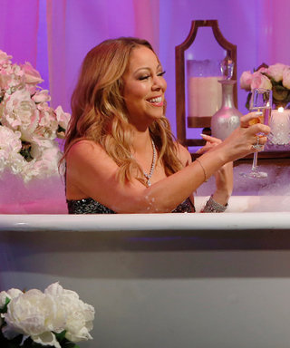 Mariah Carey Gets Interviewed in a Bathtub Wearing a Sparkling Evening Gown and Heels