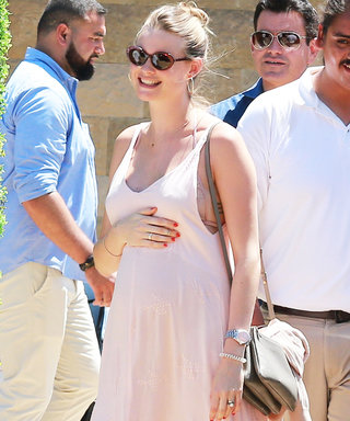 Behati Prinsloo Shows Off Her Baby Bump in a Pretty Pink Maxi Dress