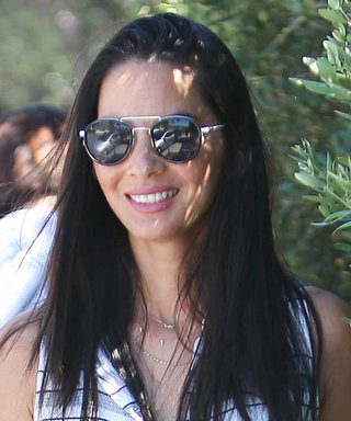 Olivia Munn Dares to Rock the Tiniest Shorts and Over-the-Knee Suede Boots in the Summer