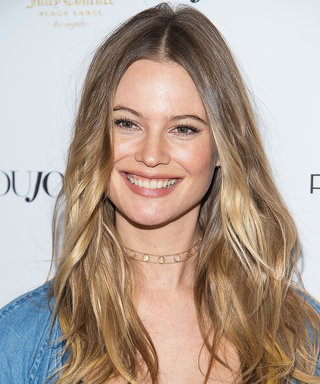 Behati Prinsloo Shows Off Growing Baby Bump in Flowing Maxi Dress