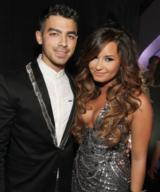 Friendly Exes Demi Lovato and Joe Jonas Share a Hug and Duet on the Future Now Tour