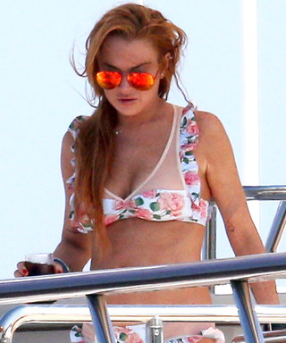 Lindsay Lohan Brushes Off the Drama While Yachting in a Flirty Floral Bikini