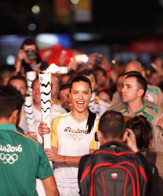 Adriana Lima Carries Olympic Torch with Pride Through the Streets of Rio