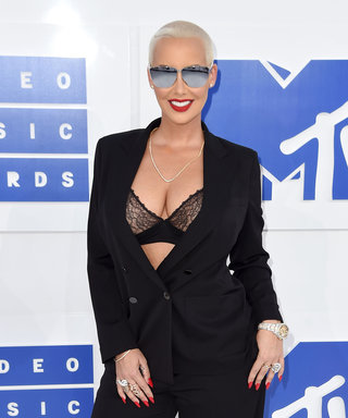Amber Rose Stuns in Bra-Baring Suit and Talks Hair Changes at the MTV VMAs