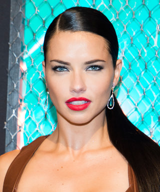 Adriana Lima Puts Her Toned Bod on Display in a Wraparound Leather Top