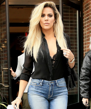 Khloé Kardashian Shows Off Her Assets in Sheer PlungingTop and Curve-Hugging Skinny Jeans