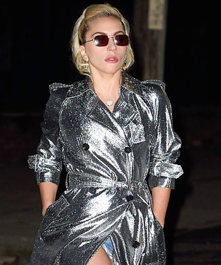 Lady Gaga Rocks Shimmering Silver Trench Coat Over Denim Cutoff Shorts in N.Y.C.