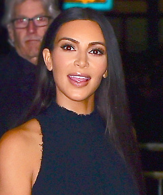 Kim Kardashian West Stuns in Slinky Keyhole Maxi and Snakeskin Boots Ahead of Paris Fashion Week