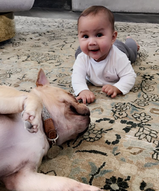 "Chrissy Teigen Shares the Sweetest Snaps of Baby Luna and Her ""Best Bud"""
