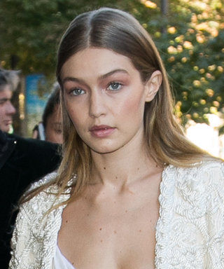 Gigi Hadid Artfully Pairs White Sneakers with a Woven Rope Jacket and Pearl-Covered Jeans