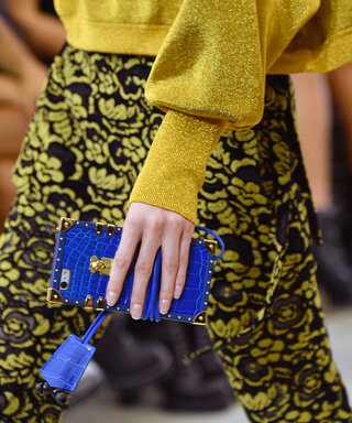 Louis Vuitton Turned Its Petite Malle Clutch Into a Phone Case and We've Never Been More Obsessed