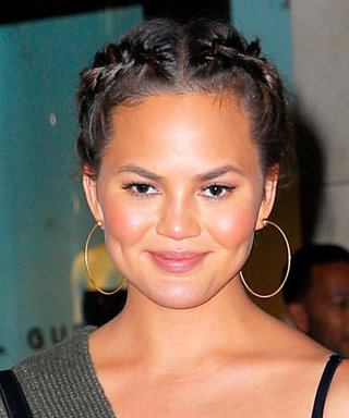 Chrissy Teigen Glows in Plunging Olive Green Sweater During Family Night Out in N.Y.C.